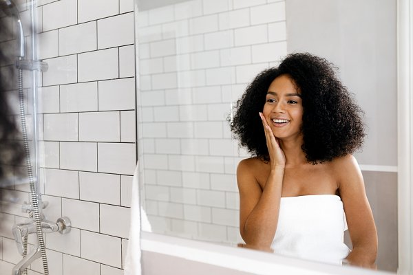 Young woman standing in bathroom