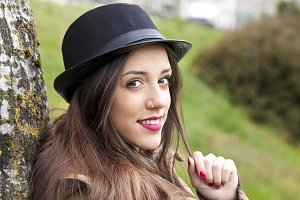 portrait of girl with hat outdoors