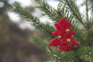 Red christmas tree on branch
