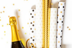 Shopping bag with wrapping paper and bottle of champagne
