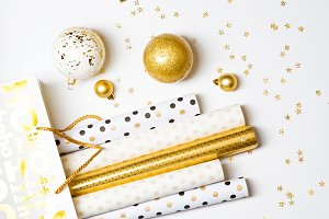 Christmas wrapping paper and golden balls