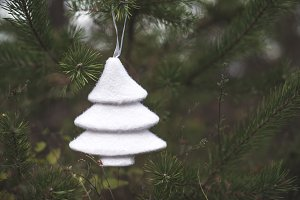 White christmas tree hooked on fir