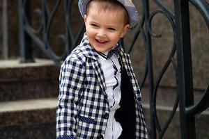 stylish baby boy having fun outside