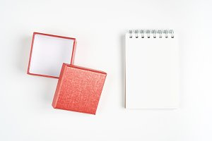 Red gift box,and empty notebook.