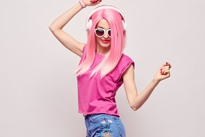 DJ Girl Hipster with Pink Fashion Hairstyle Dance.