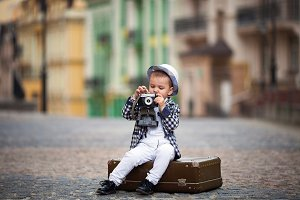 little boy and retro camera