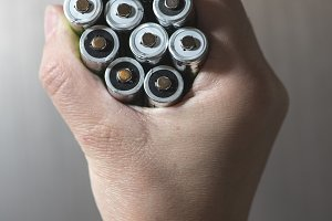 Hand hold many batteries