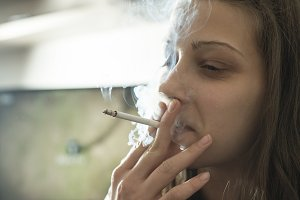 Girl smoke cigarette