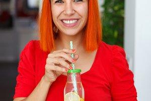 Pretty red hair woman at home