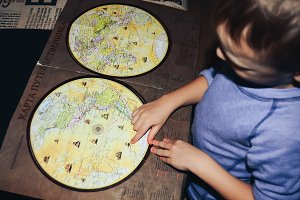 Little boy shows world map