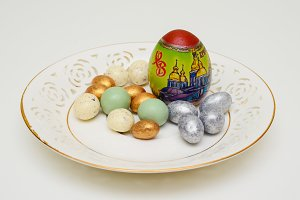 Easter eggs and candy on the saucer