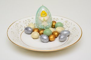 Easter eggs on a plate and angel