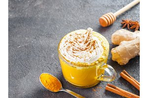 golden turmeric latte and ingredients, copy space