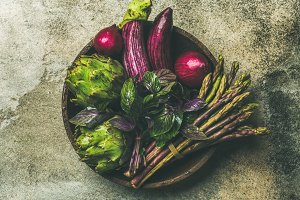 Flat-lay of green and purple vegetables