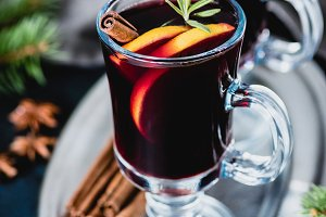 Mulled wine with cinnamon, orange and rosemary in glass
