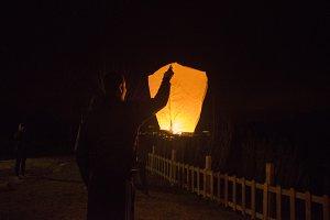 Man with Sky lantern