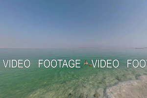 Man swimming in pure salt water of Dead Sea, Israel