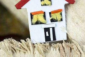 House miniature on wooden boards