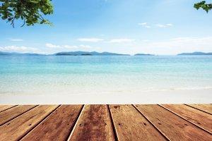 wood terrace over blue sea
