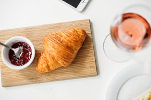 Croissant with jam on the table