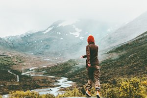Woman walking outdoor foggy mountain