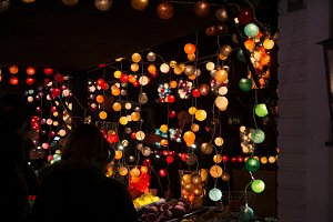TOULOUSE, FRANCE - NOVEMBER 30, 2016, Lighting stand, lights inside colorful Christmas balls, at night, Christmas market in Toulouse, France