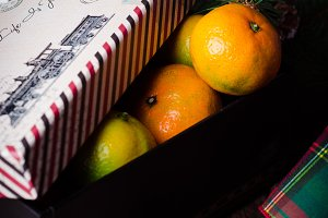 Christmas New Year Composition with Tangerines parsel Boxes on vintage Background Holiday Decoration. New year mood. Toned image. Selective focus