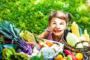 The lovely girl plays with vegetables