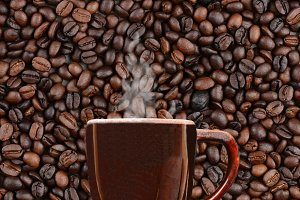 Mug of Coffee on Bean Background