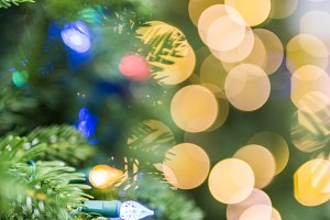 Christmas tree and gold light bokeh
