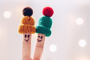 Funny couple fingers on knitted wint