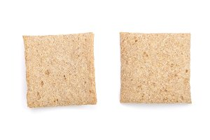 two grain crispbreads isolated on white background. Top view