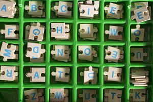 Letters on vintage wooden puzzle