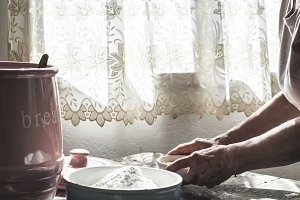 Senior woman prepare bread