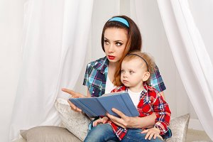 Mother and daughter read ebook