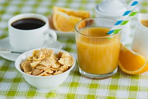 Cup of coffee, muesli and orange juice