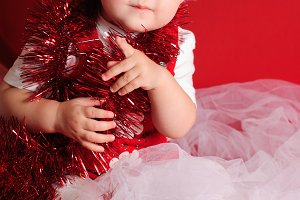 Girl santa on red cloth