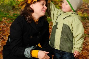 Boy and mother in autumnal park