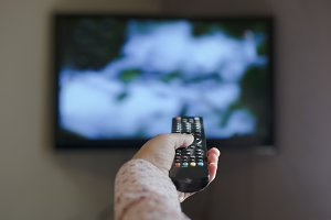 TV and hand hold remote control