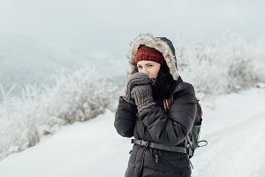 Female tourist feeling cold