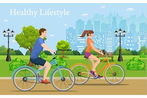 Couple Riding Bicycles In Public Park,