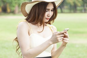 Woman playing smart phone.