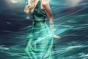 beautiful girl in evening dress surrounded by light