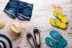 Summer vacation composition. Denim shorts, hats and flip flops.