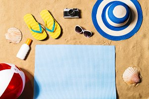 Summer vacation composition. Sandals, hat and beach ball.