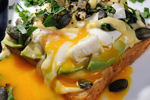 Eggs Benedict with avocado on toast