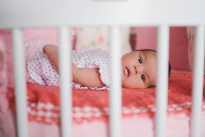 cute newborn baby lying in bed