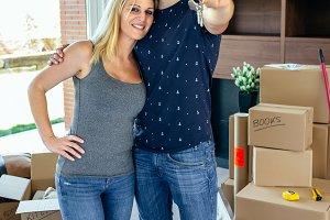 Moving couple showing keys