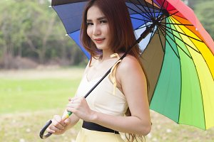 Woman holding multicolored umbrella