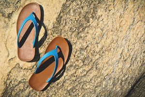 blue sandal on stone background